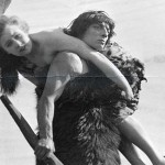 (Original Caption) Buster Keaton dressed as a caveman carrying off a woman in Joseph M. Schenck's The Three Ages. A Metro Comedy.